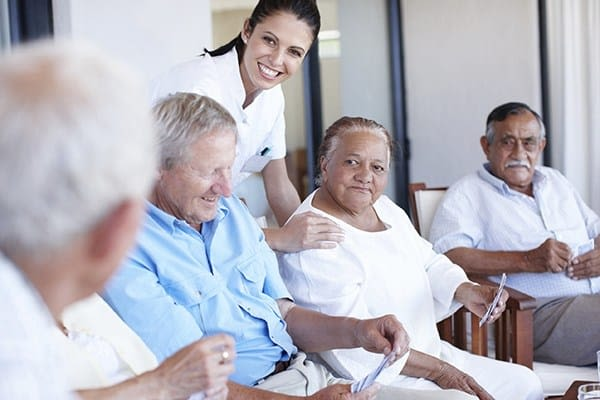 Nurse chatting with seniors at Pacifica Senior Living Palm Springs in Palm Springs, California