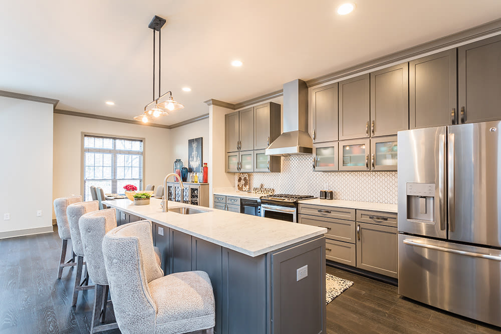 Enjoy apartments with a modern kitchen and breakfast bar at Waters Edge Apartments in Webster, New York