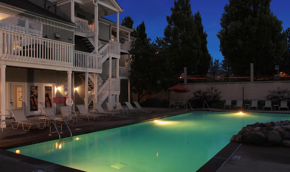 Outdoor pool at night at Island Club Apartments