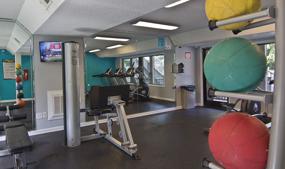 Modern fitness center at apartments in Raleigh, North Carolina