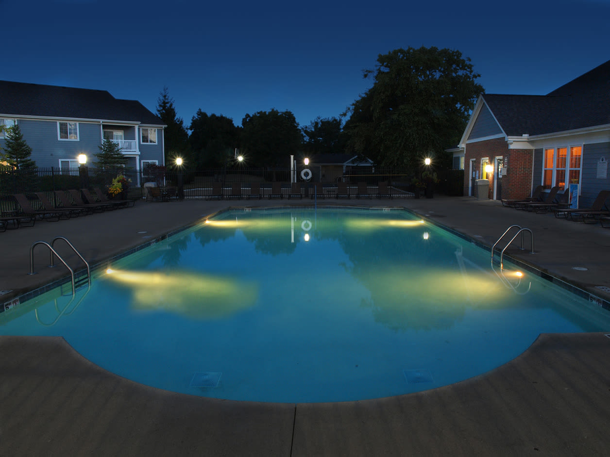 Swimming pool lit up at night at Sterling Lakes in Mason, Ohio