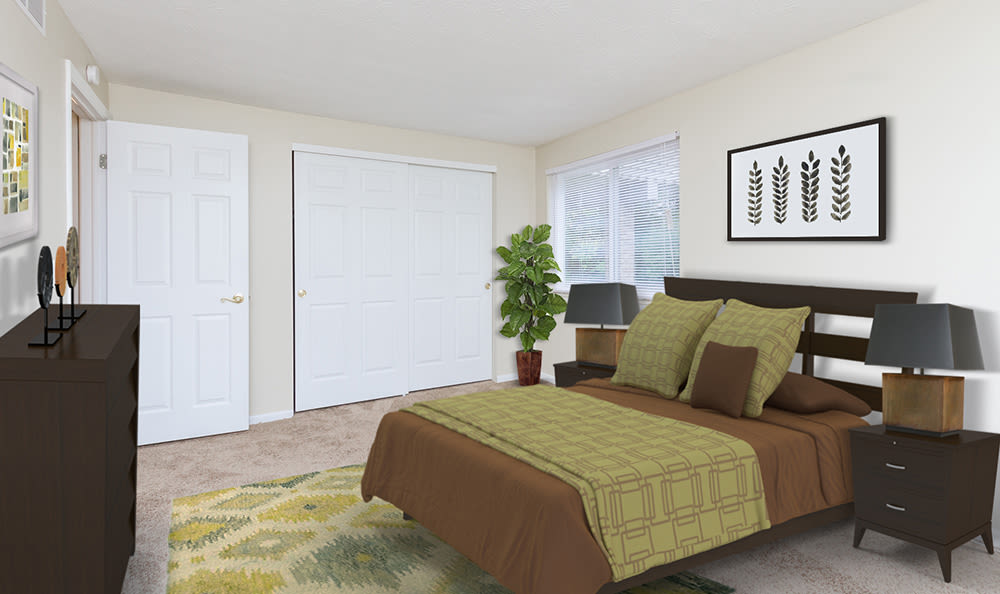 Beautifully designed bedroom at Newcastle Apartments home in Rochester, New York