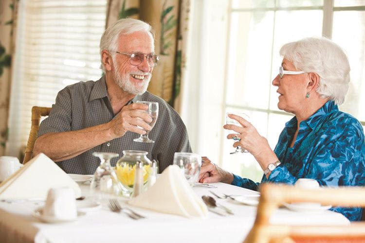 Senior living couple dine together at Discovery Commons in Bonita Springs, Florida