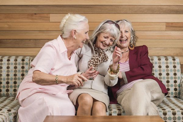Senior living residents laughing at Discovery Commons in Bonita Springs, Florida
