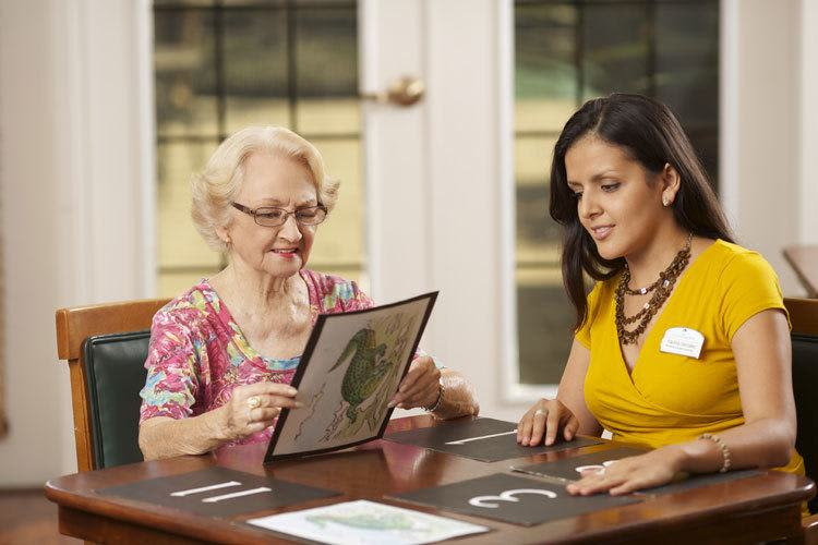 Senior living resident with a memory care specialist at Discovery Commons in Bonita Springs, Florida
