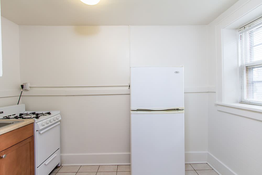 Fridge in apartment at Mayflower Apartments