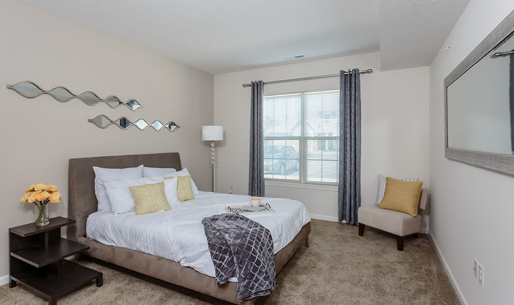 Bedroom at Auburn Creek Apartments in Victor