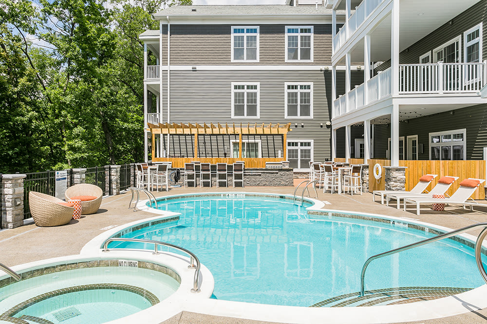 Hot tub and swimming pool at Waters Edge Apartments in Webster, New York