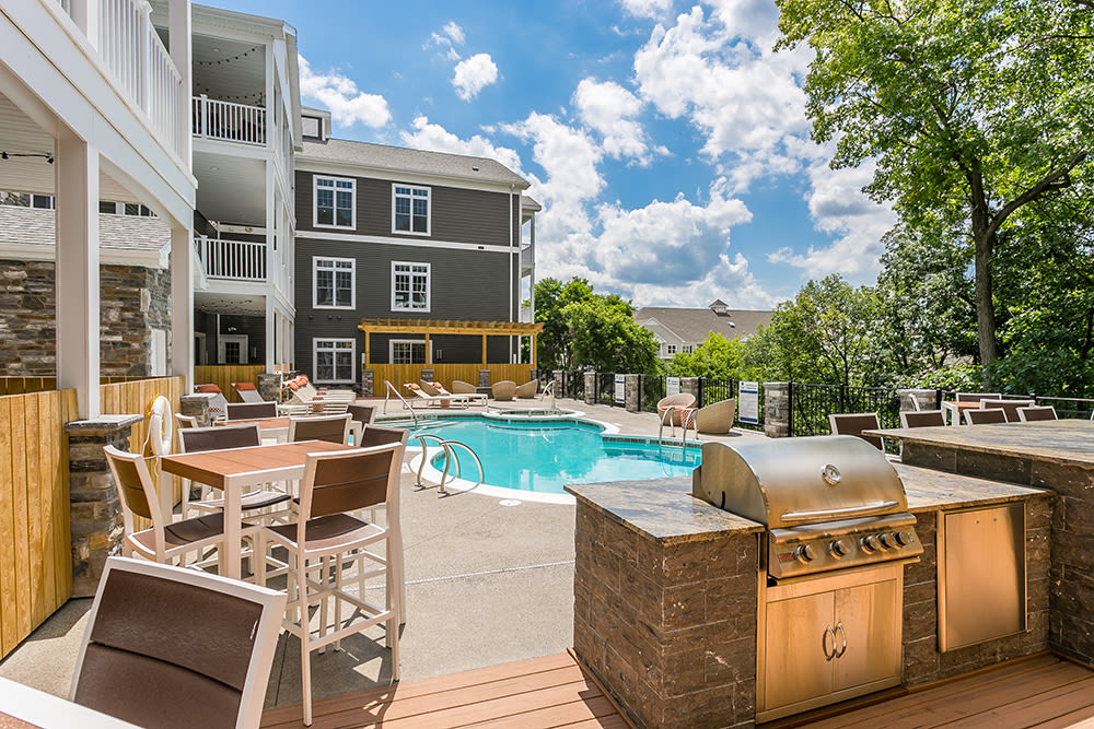 Grilling station and swimming  pool at Waters Edge Apartments in Webster, New York