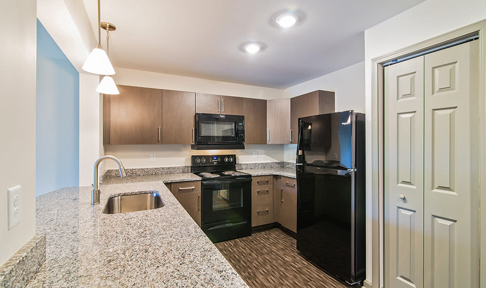 Beautifully designed kitchen at Greenwood Cove Apartments home in Rochester