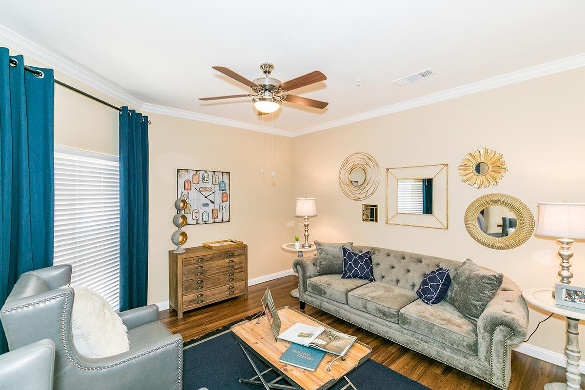 Modern decor in spacious living room of model home at Hilltops in Conroe, Texas