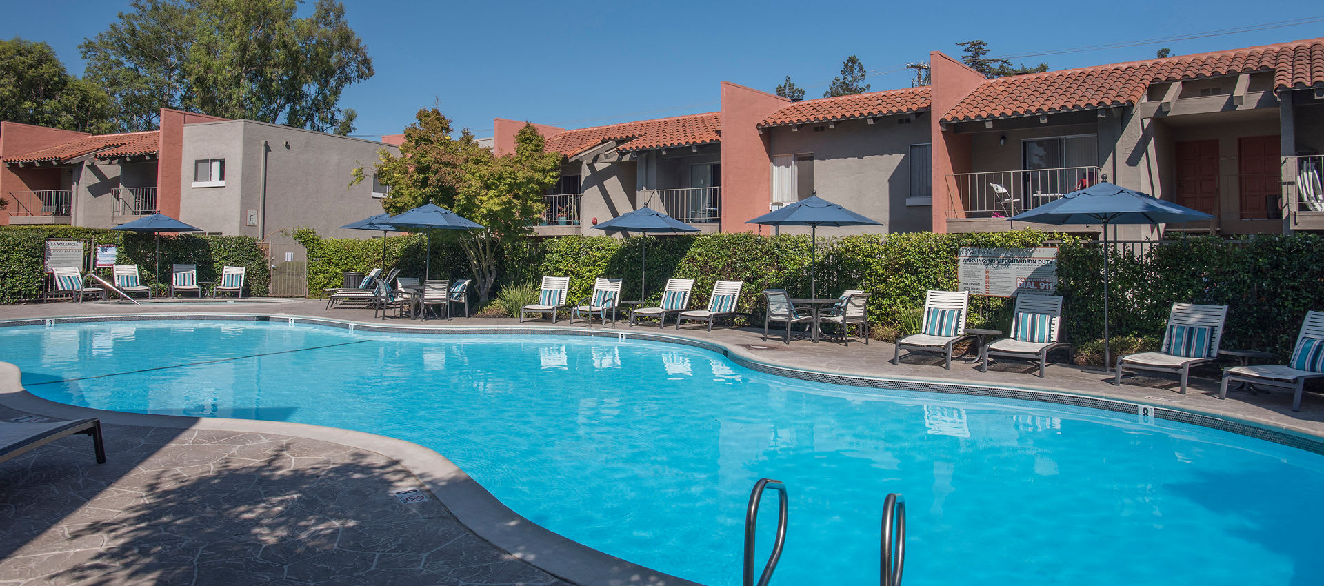 Swimming pool at La Valencia Apartment Homes in Campbell, California