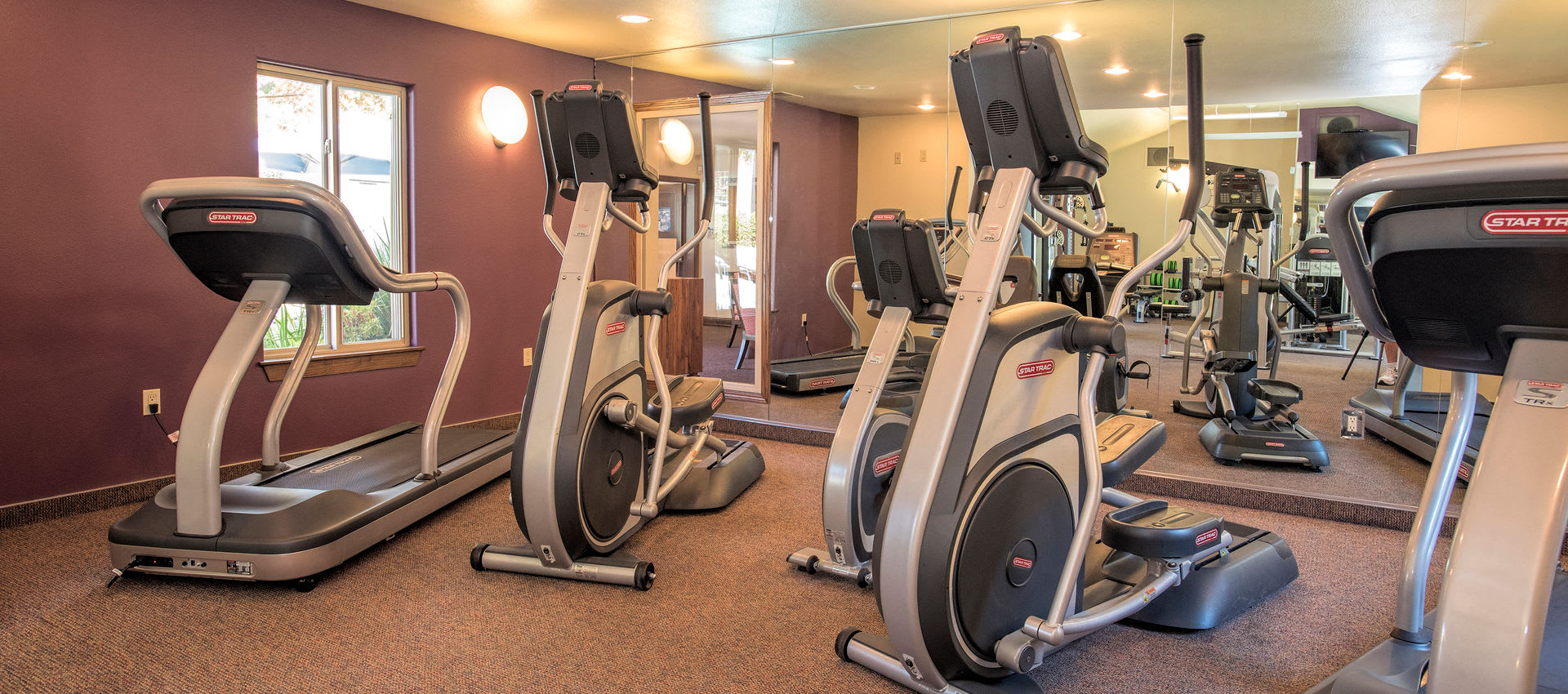 Exercise room at La Valencia Apartment Homes in Campbell, California