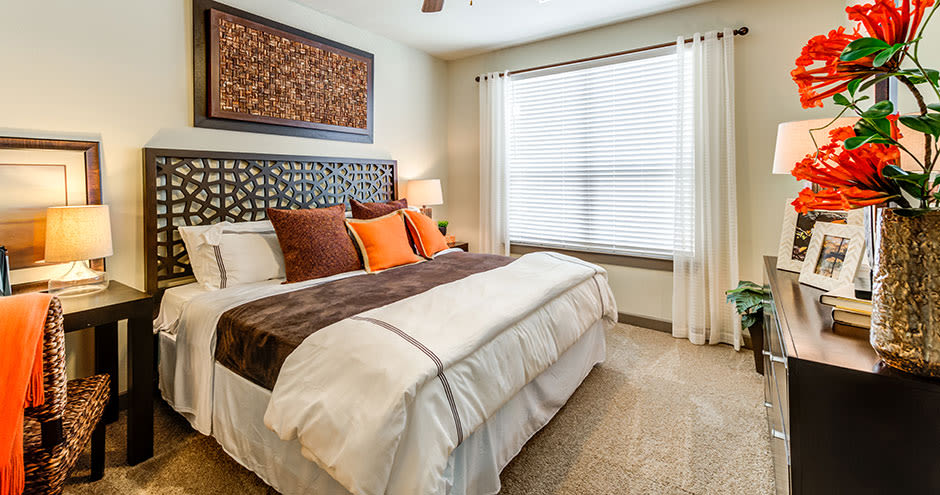 GreenVue Apartments offers a natrually well-lit bedroom in Richardson, Texas