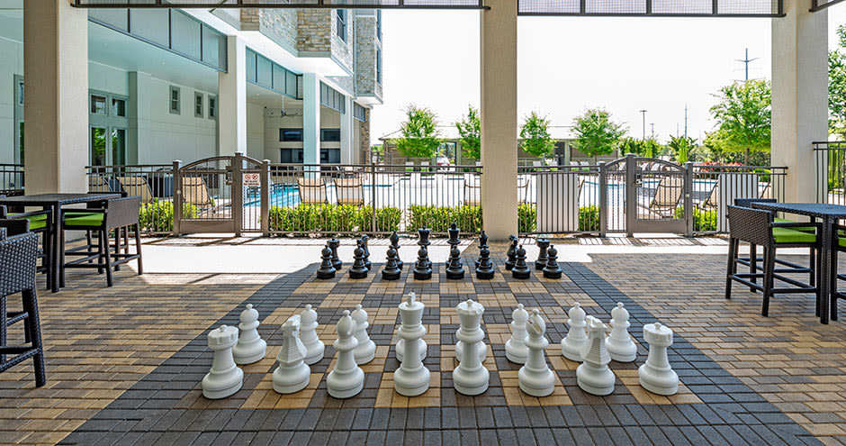 Giant chess board by the pool at GreenVue Apartments in Richardson, Texas