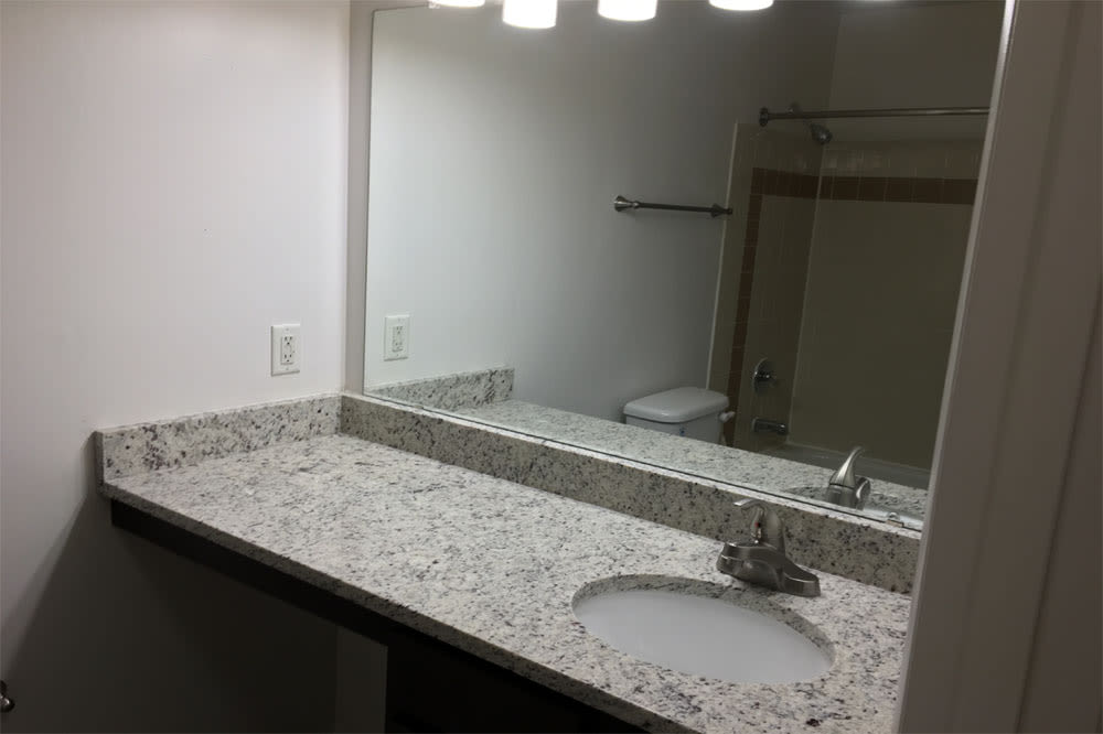Enjoy apartments with a modern bathroom at Reflections at Virginia Beach