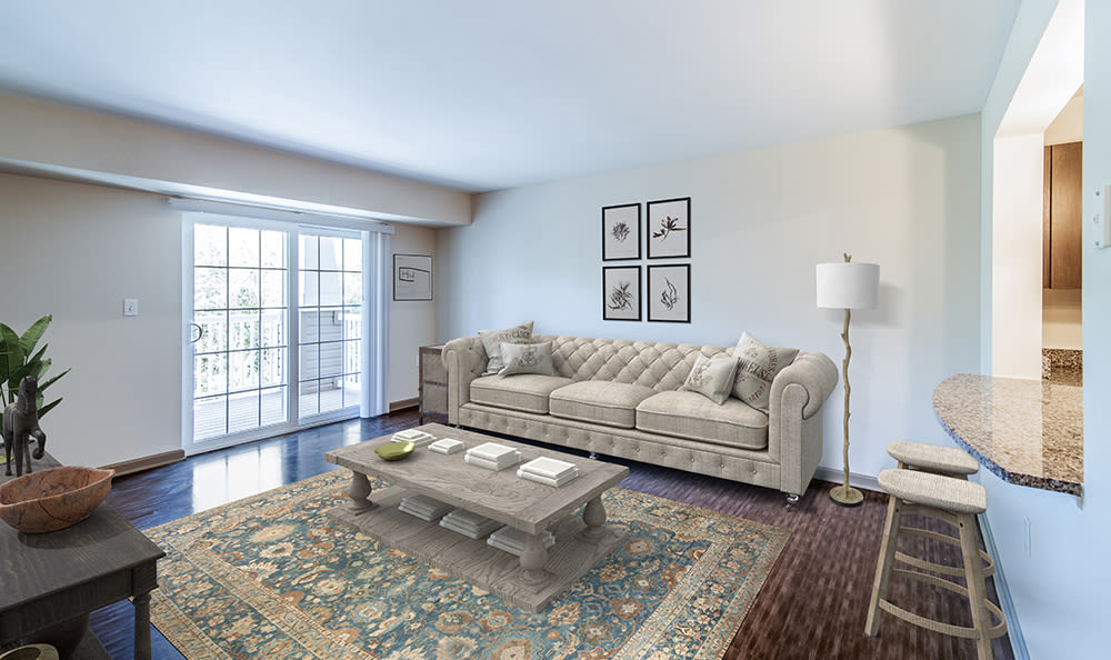 Spacious living room at Greenwood Cove Apartments in Rochester, New York