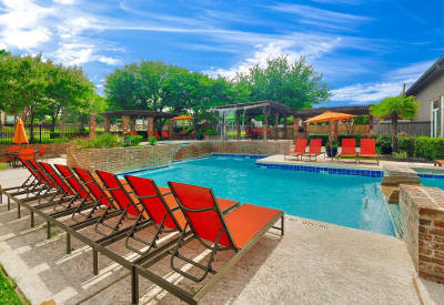 Sundeck and pool at Village Green of Bear Creek in Euless, Texas
