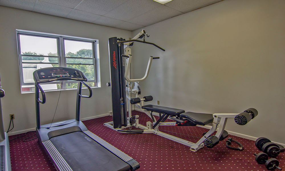 Enjoy apartments with a fitness center at The Cascades Townhomes and Apartments