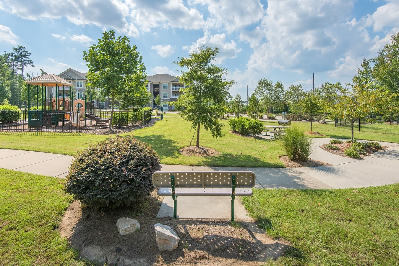 Outdoor seating areas and walking trails at apartments in Raleigh, North Carolina