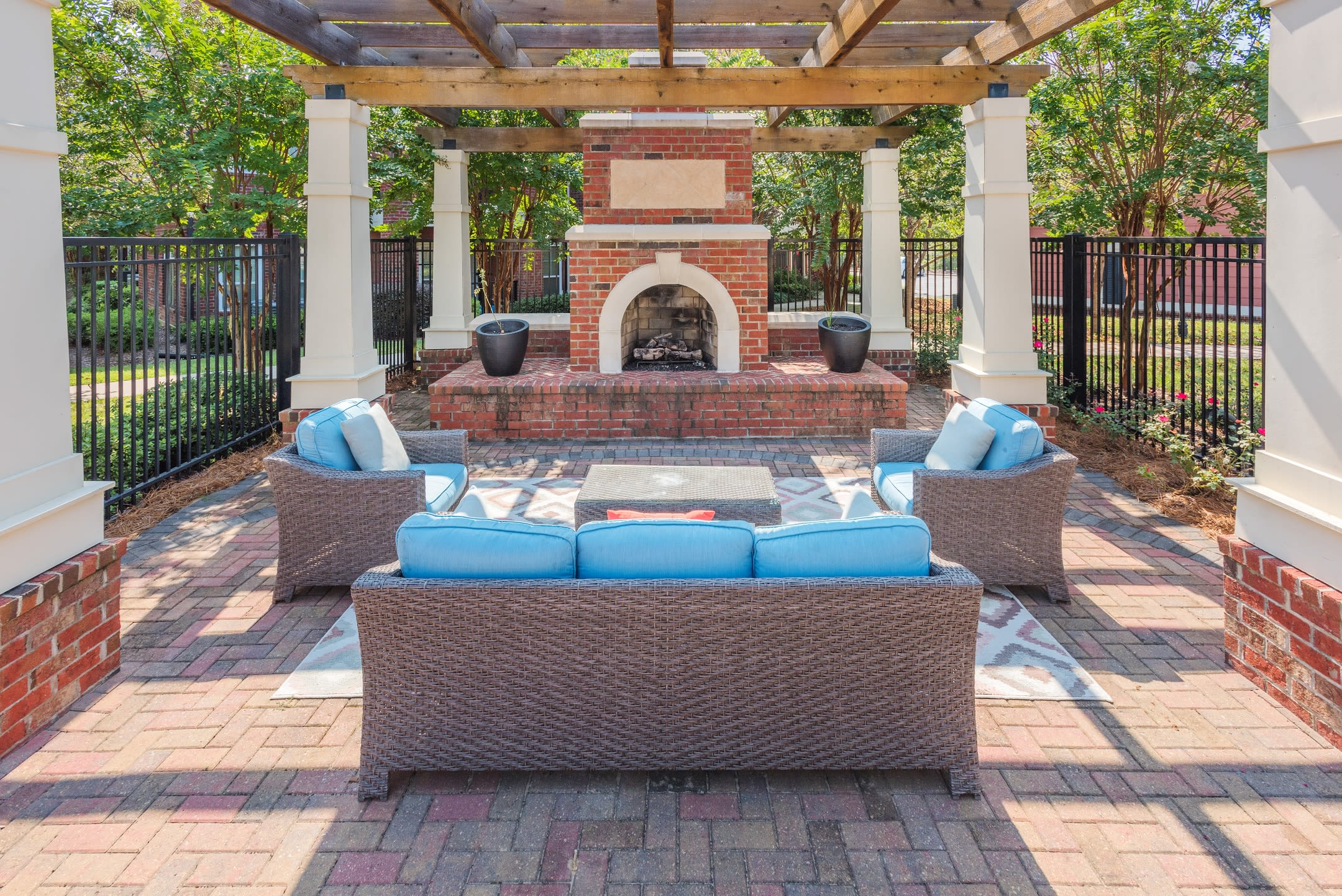 Relaxing poolside lounges with fireplace at The Vive in Kannapolis, North Carolina