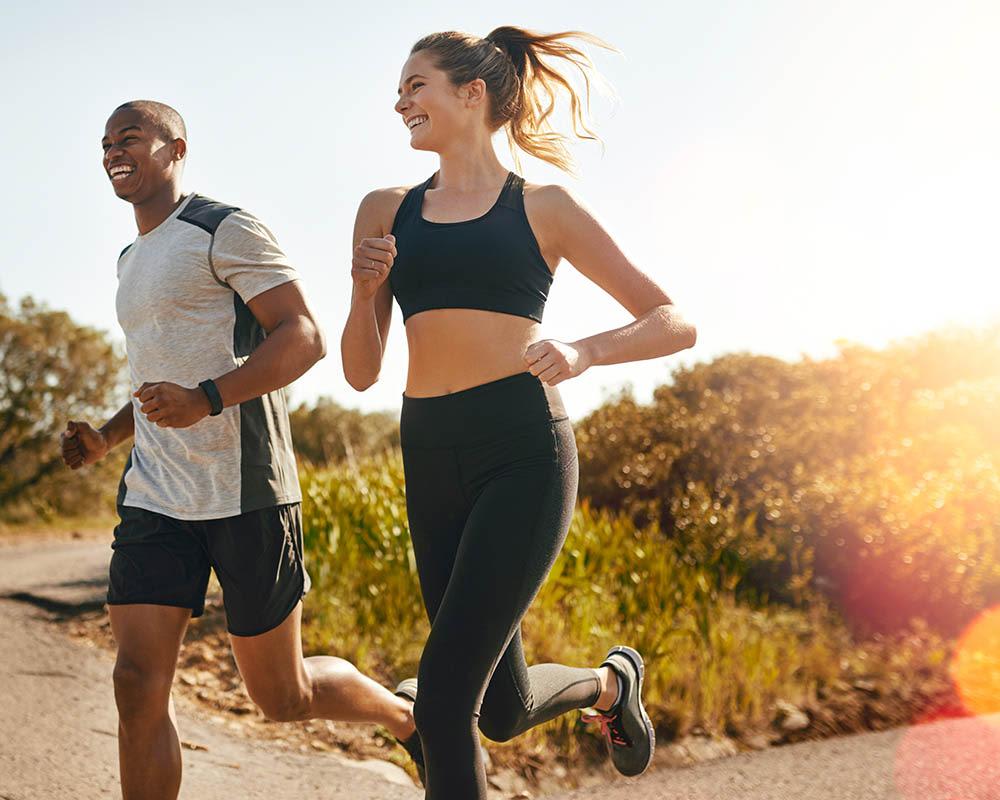 A couple running near The Copeland in Austin, Texas