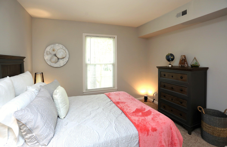 Naturally well-lit bedroom at apartments in Greensboro, North Carolina
