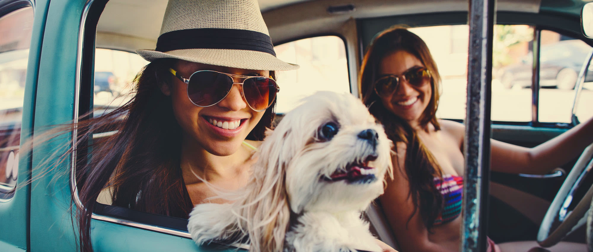 Girls with a cute doggy at University Pet Resort in Merced, California