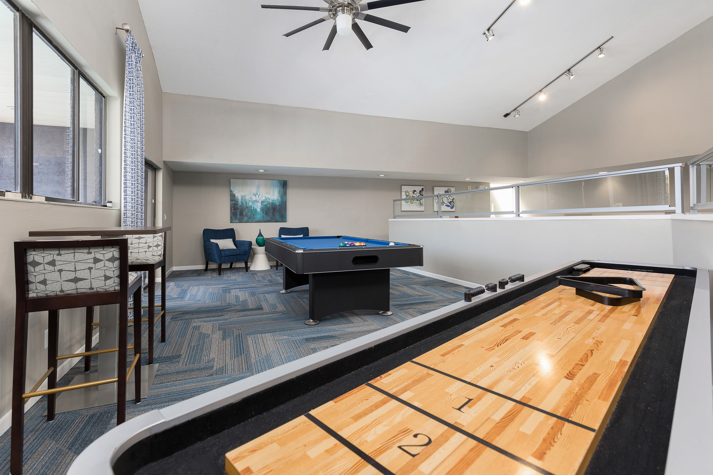 Clubhouse with billiards and shuffleboard poolside at WestEnd At 76Ten in Tampa, Florida