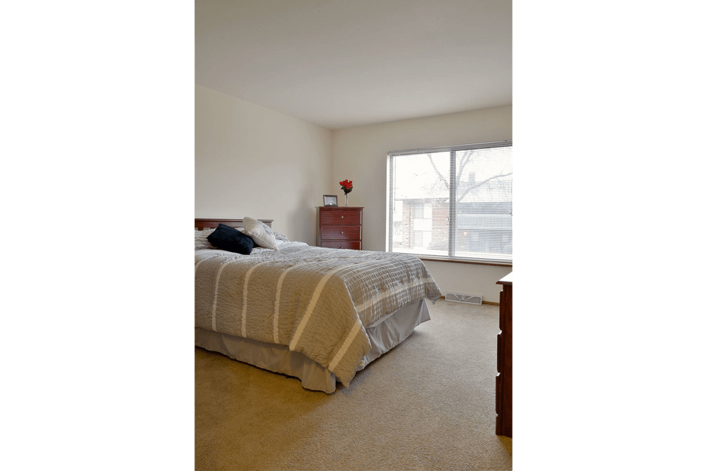 Spacious bedrooms at American Colony Apartments