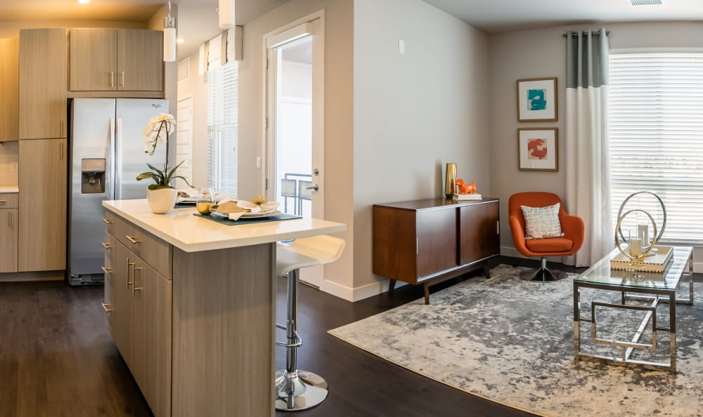Living room and kitchen at Strata Apartments in Denver, Colorado