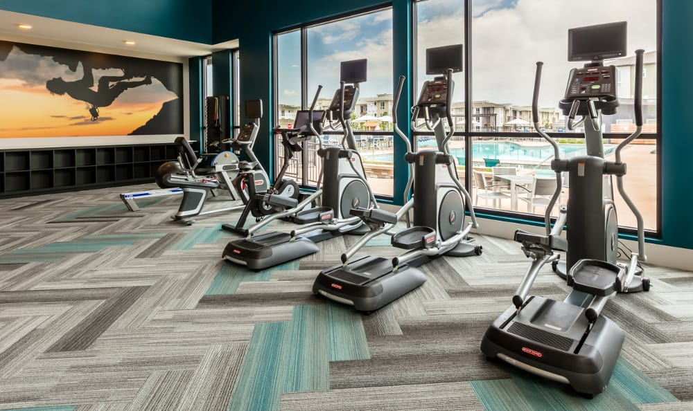 Treadmills in fully-equipped fitness center at Strata Apartments in Denver, Colorado