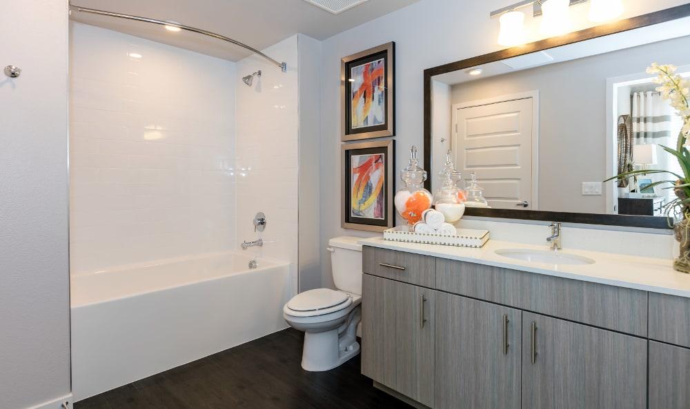 Bathroom with tub at Strata Apartments in Denver, Colorado