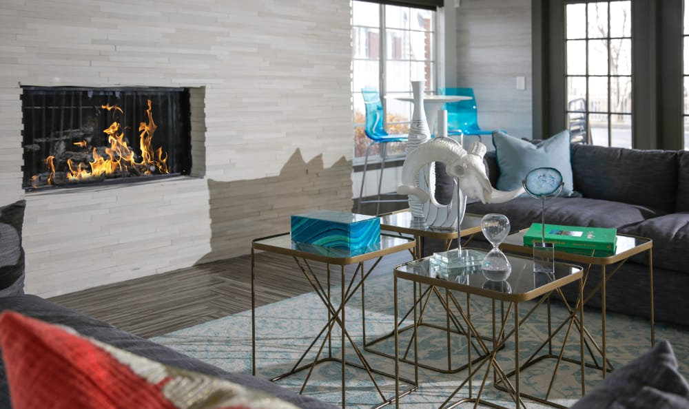 A cozy fireplace in the clubhouse at Windgate Apartments