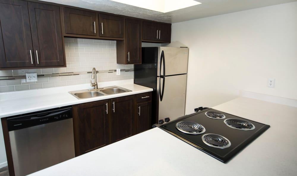 brown renovated Kitchen at Windgate Apartments in Bountiful, Utah
