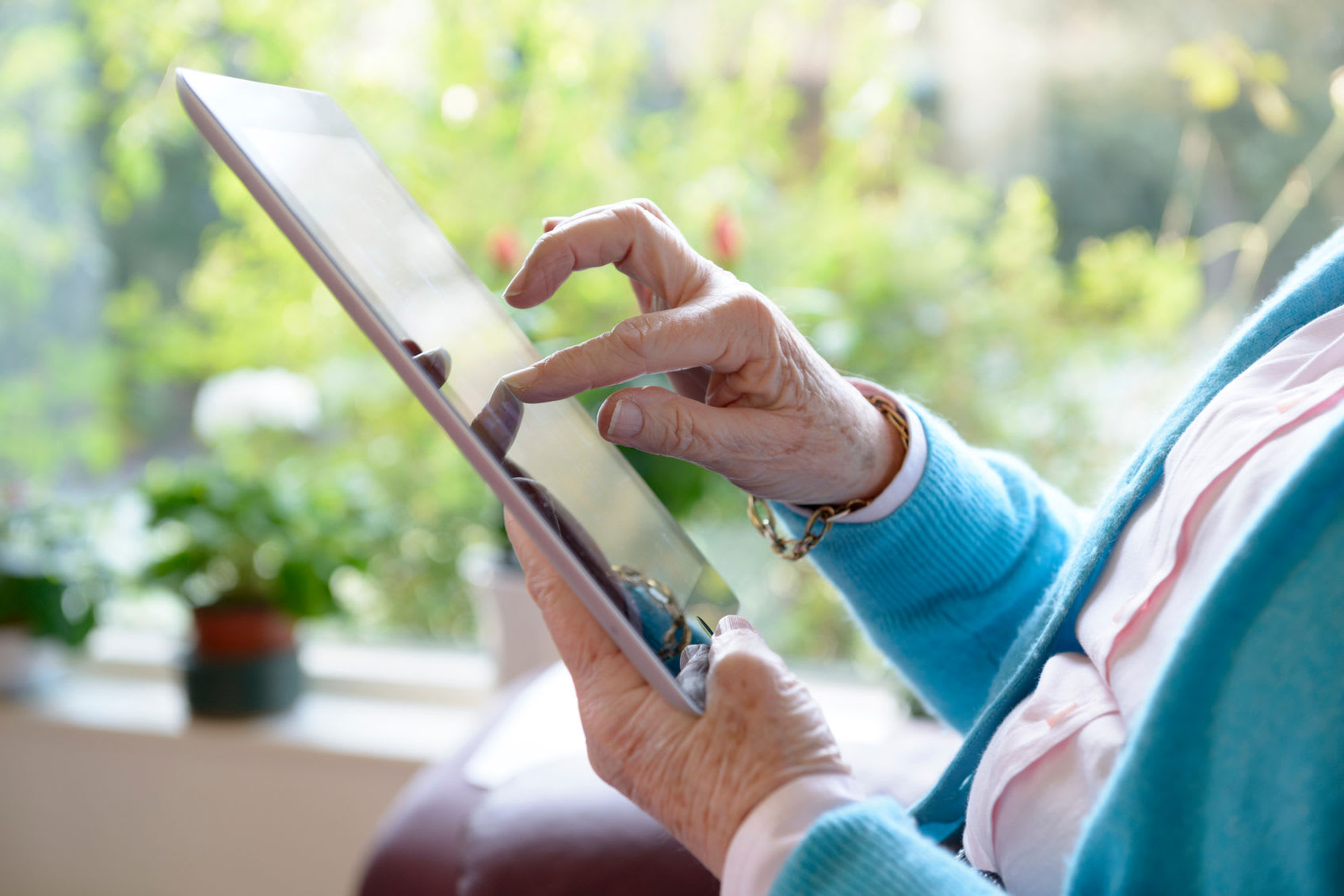 Woman using her iPad at at Clearwater at South Bay in Torrance, California