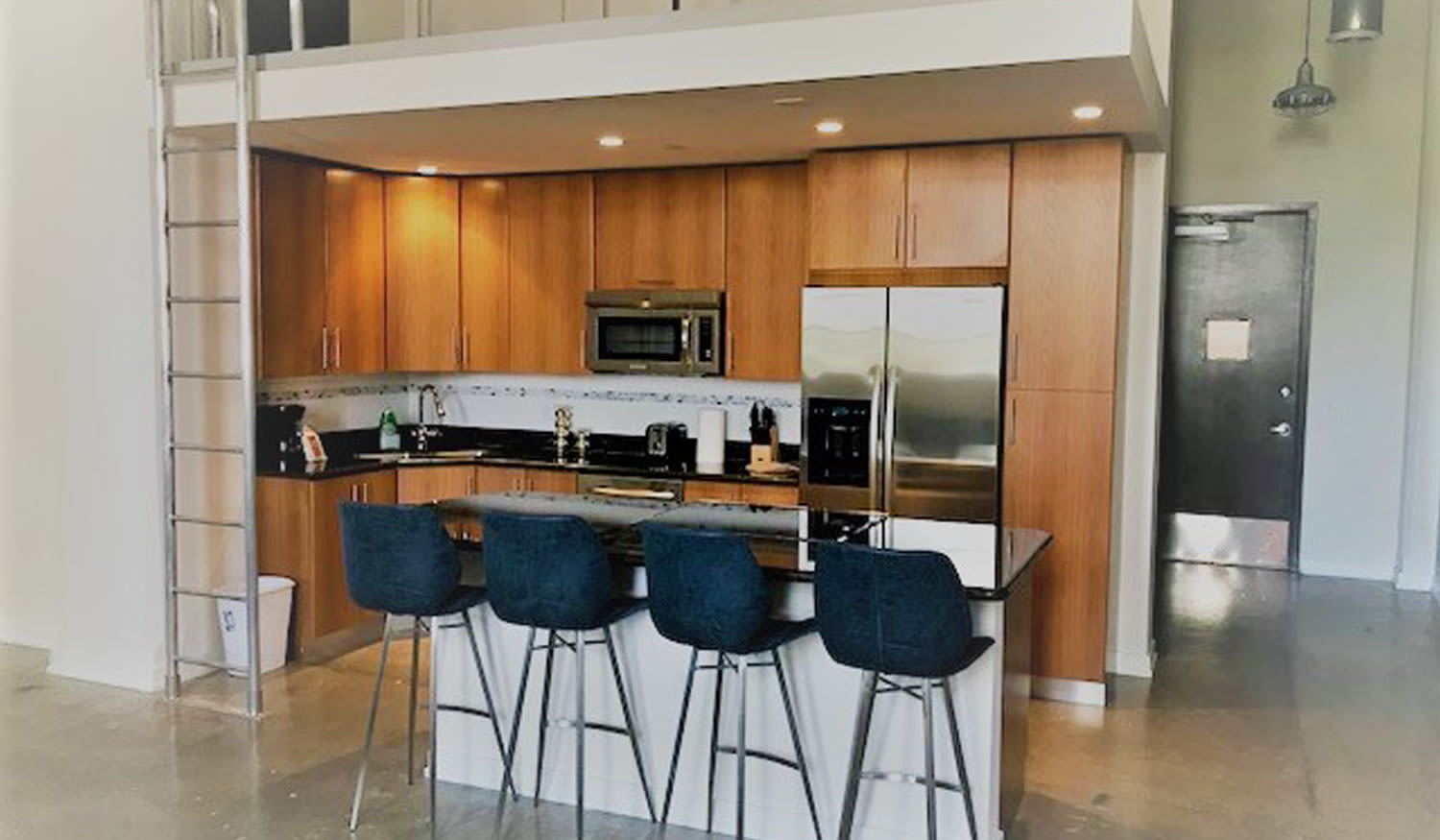 Breakfast bar next to kitchen at The Exchange Lofts in Fort Lauderdale, Florida