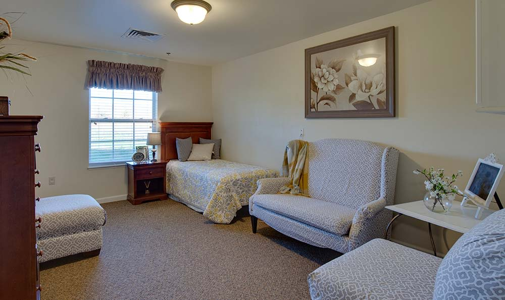 Assisted living apartment bedroom at Willow Springs Senior Living in Spring Hill, Tennessee
