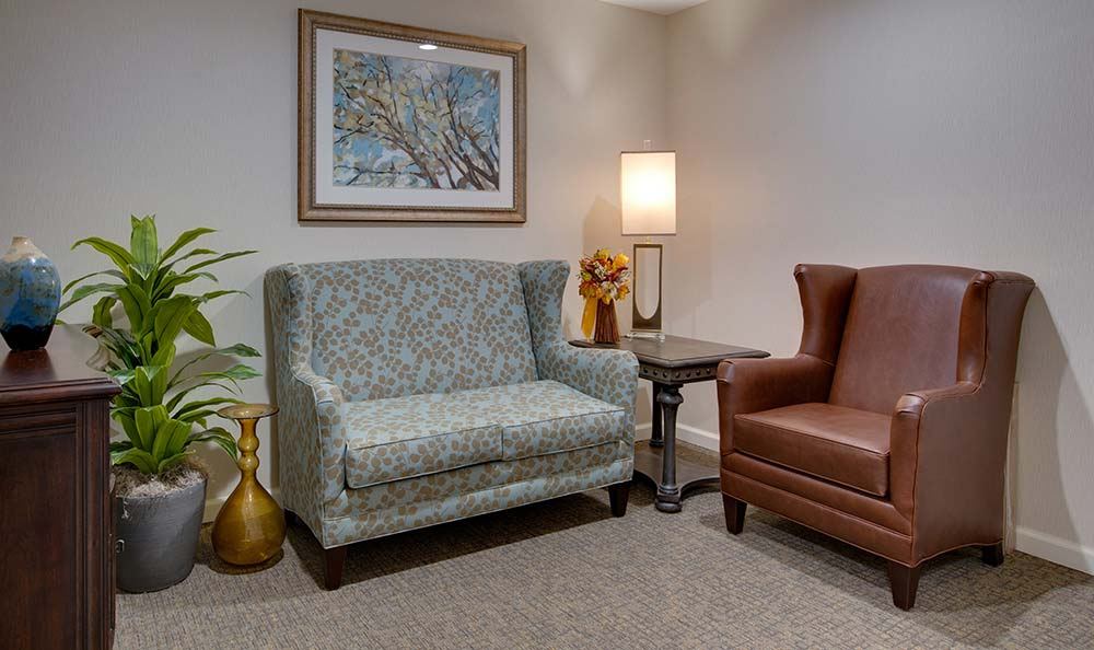 Community lounge with comfortable seating at Westport Estates Senior Living in Marshall, Missouri