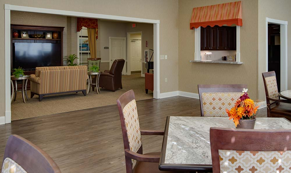Entertainment room with comfortable seating at Westport Estates Senior Living in Marshall, Missouri
