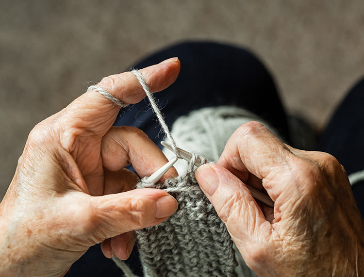 Senior making clothing at Huntington Terrace in Huntington Beach, California
