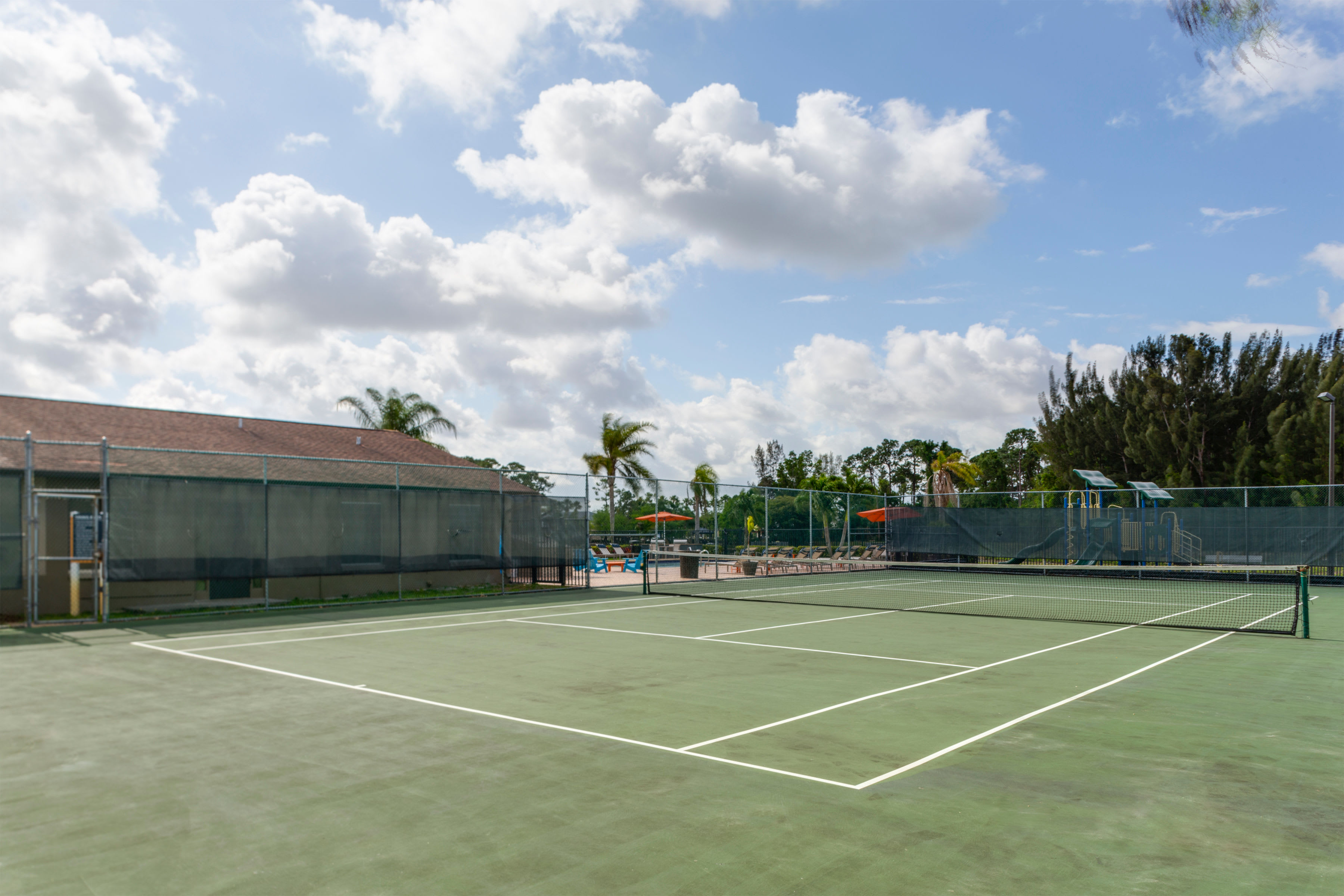 Resident tennis court at Verse at Royal Palm Beach in Royal Palm Beach, Florida