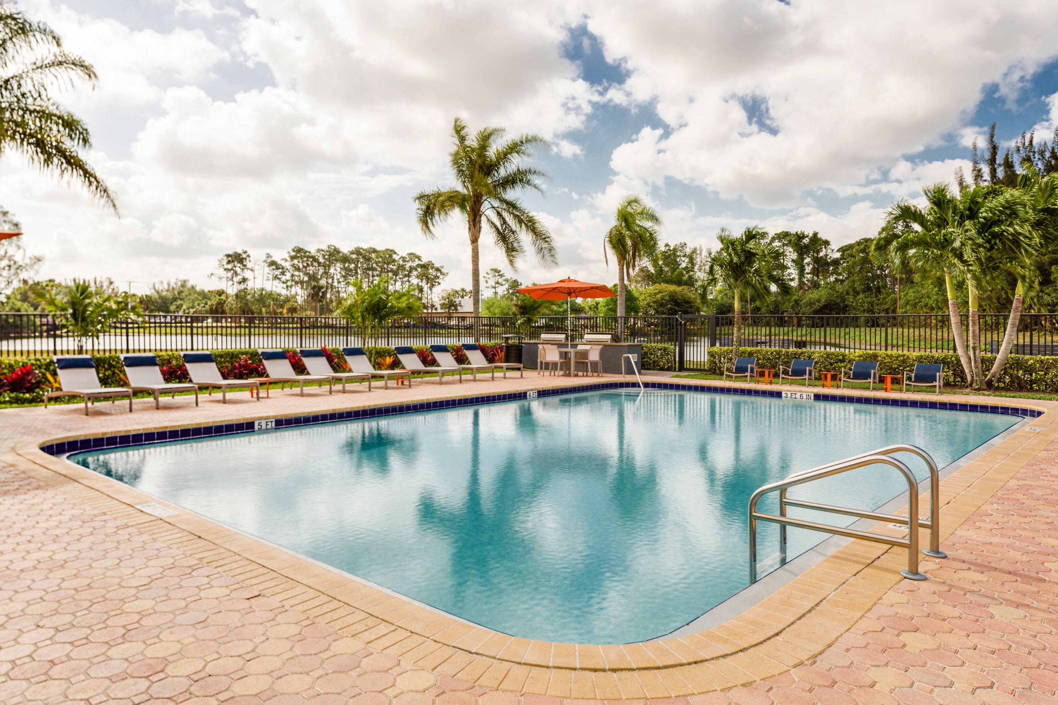 Picnic area with views of the lake at Verse at Royal Palm Beach in Royal Palm Beach, Florida