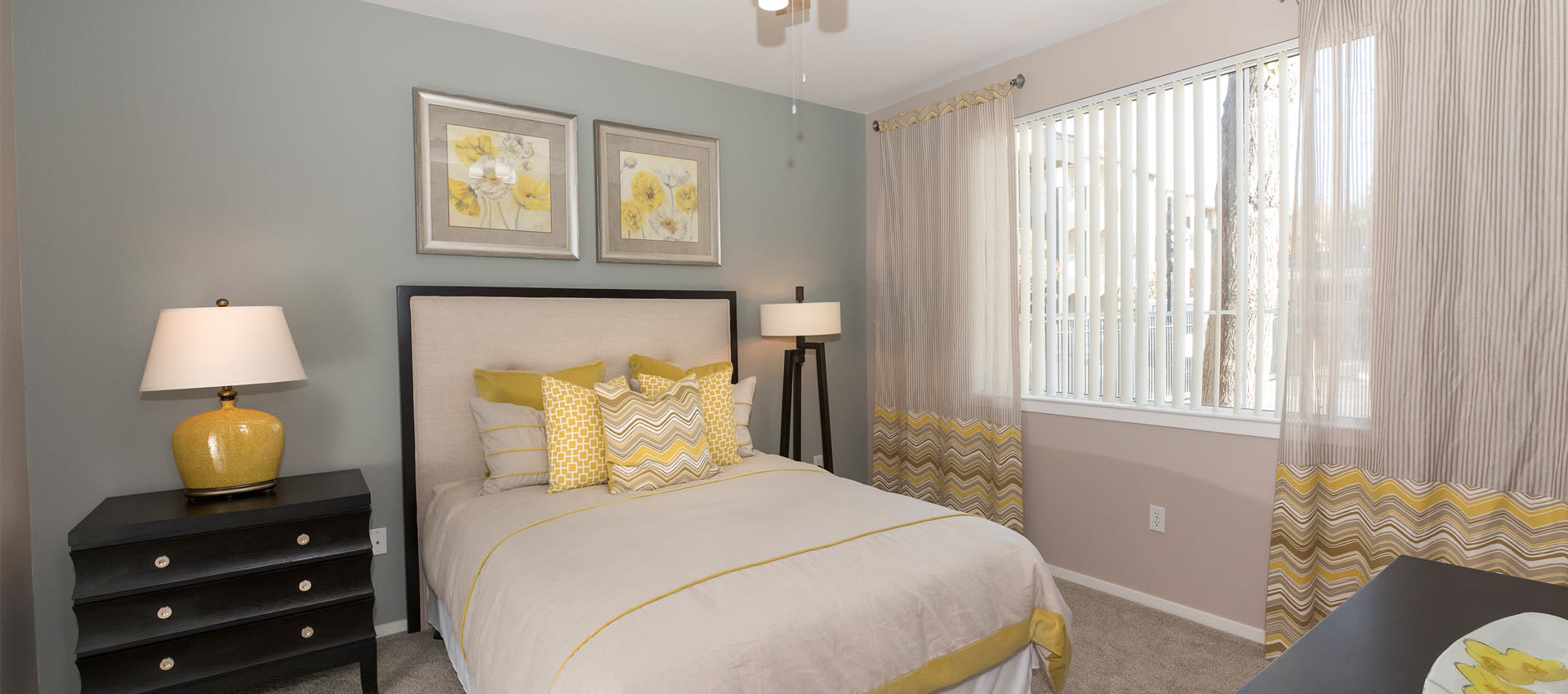 Cross Pointe Apartment Homes offers a cozy bedroom in Antioch, California
