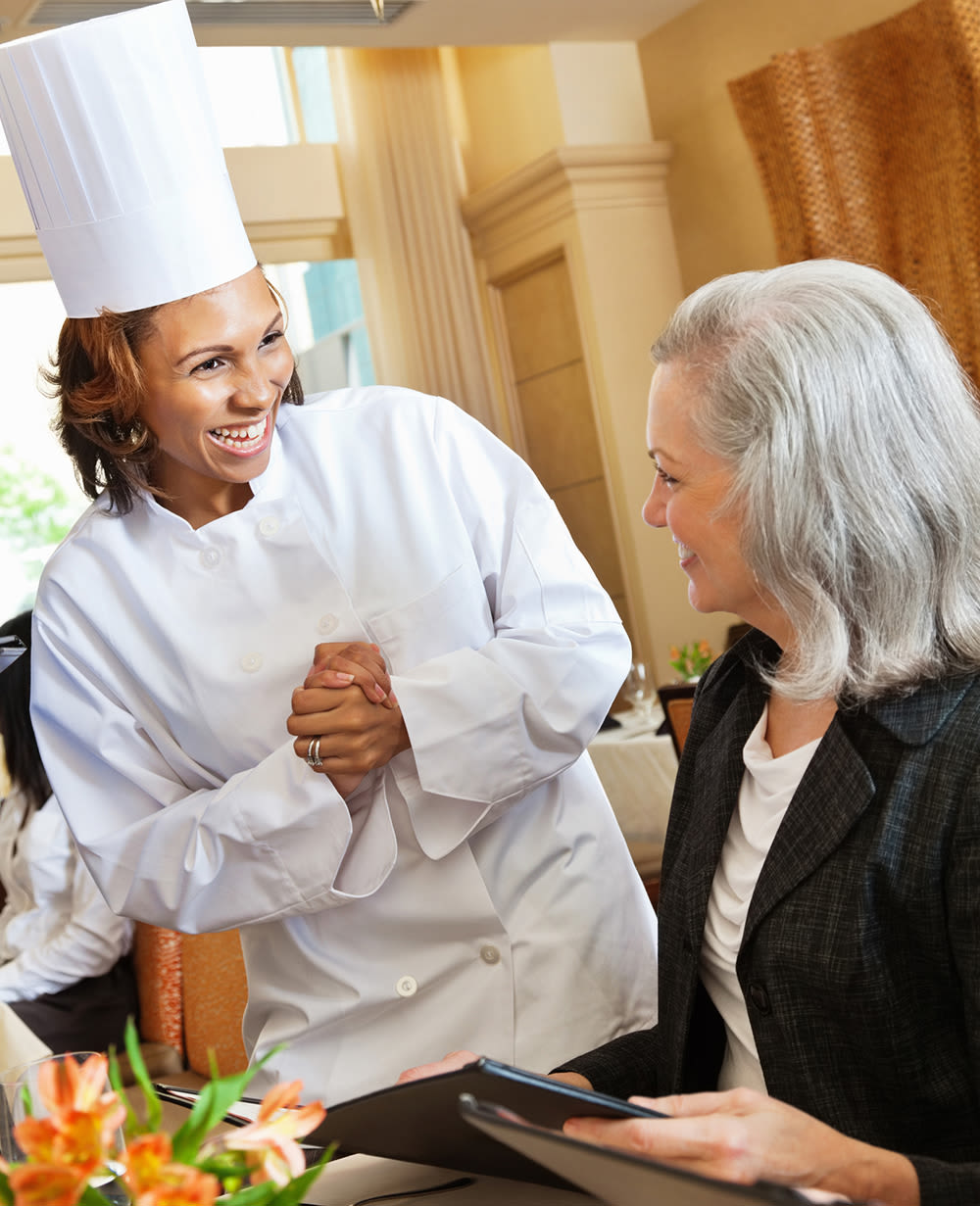 Chef with senior at Chancellor Gardens at Clearfield in Clearfield, Utah