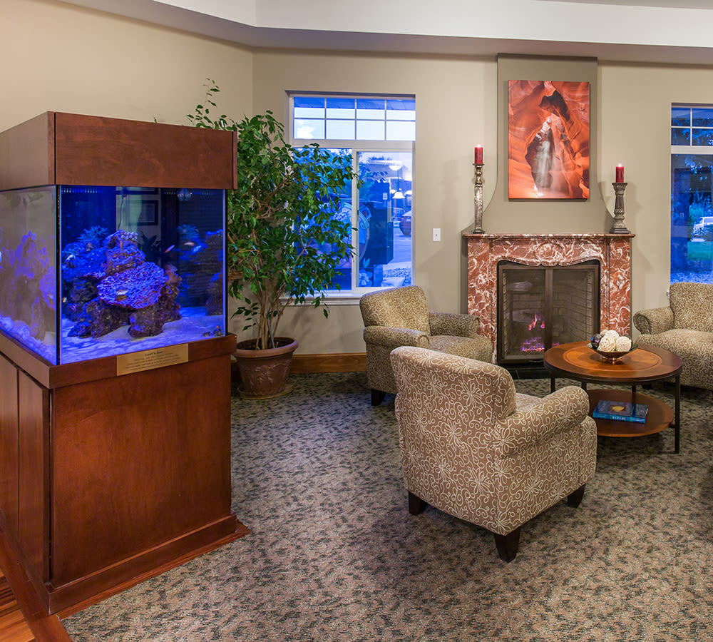 Senior common are with fish tank at Hillcrest of Loveland in Loveland, Colorado