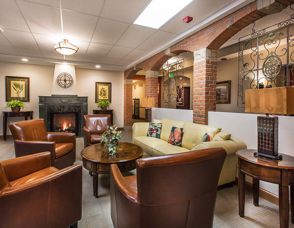 Common area with fireplace at Hillcrest of Loveland in Loveland, Colorado
