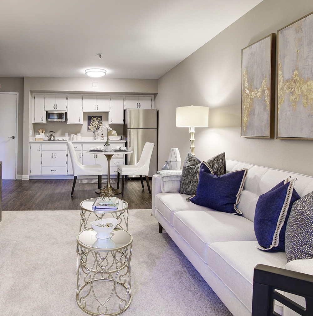 Living room with white sofa at Fairview Commons