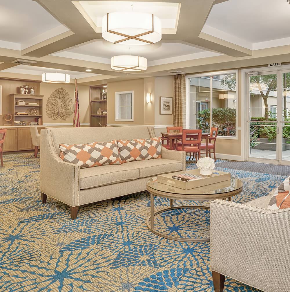 A seating area with a view of the front entrance at Island House Assisted Living in Mercer Island, Washington