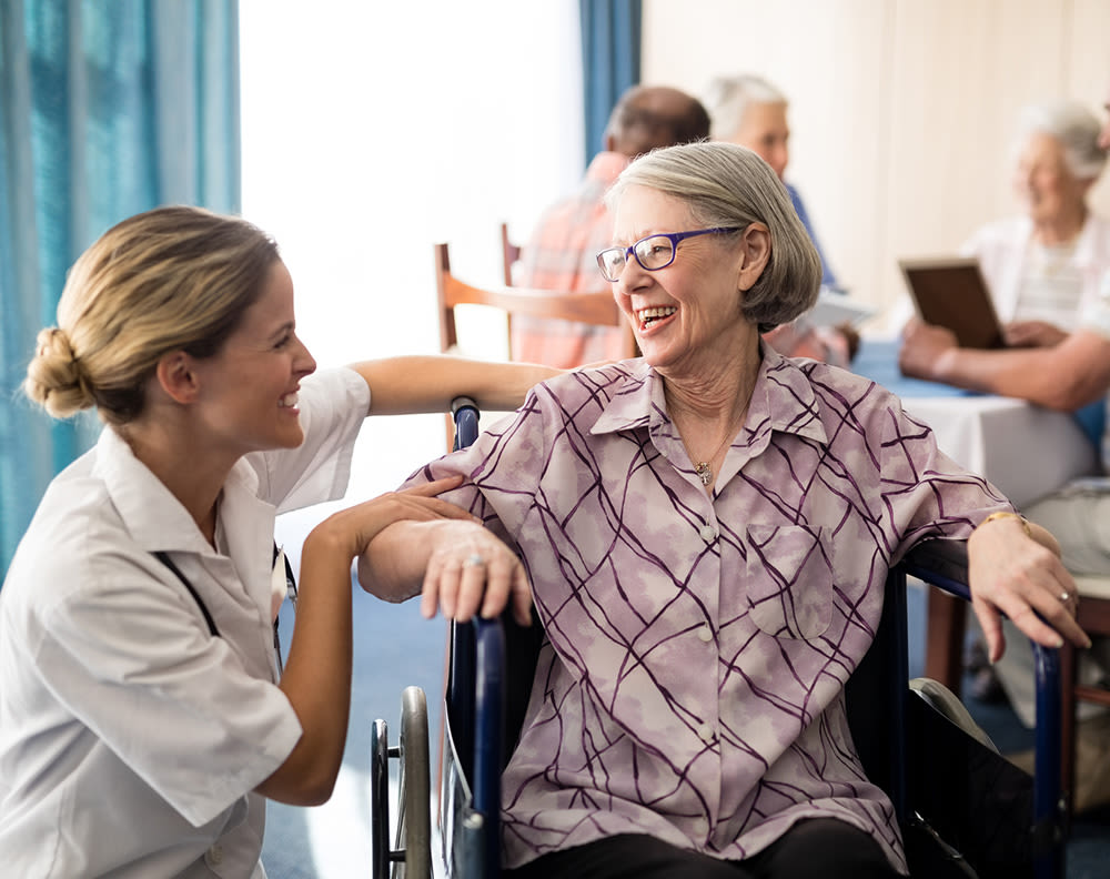 Woman laughing with senior resident at Almond Heights in Orangevale, California